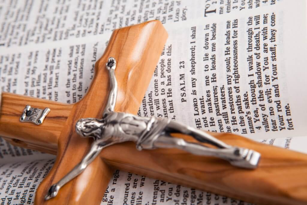 brown wooden crucifix on book page