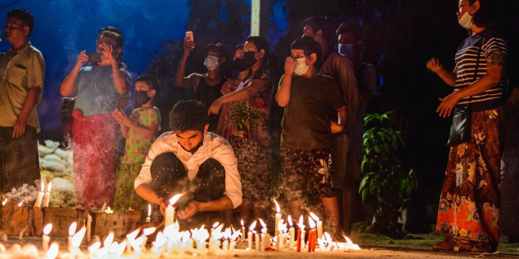 group of people holding candles